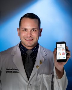 College of Dental Medicine student Corey Stein received the American Dental Association's 2016 Robert H. Ahlstrom New Investigator Award for his work on a smartphone app he created called DentaCom. He created the app to improve emergency dental care. (Jeff Malet, WesternU)